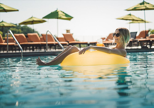 Woman floating on a tube in the pool at Grand Geneva Resort and Spa