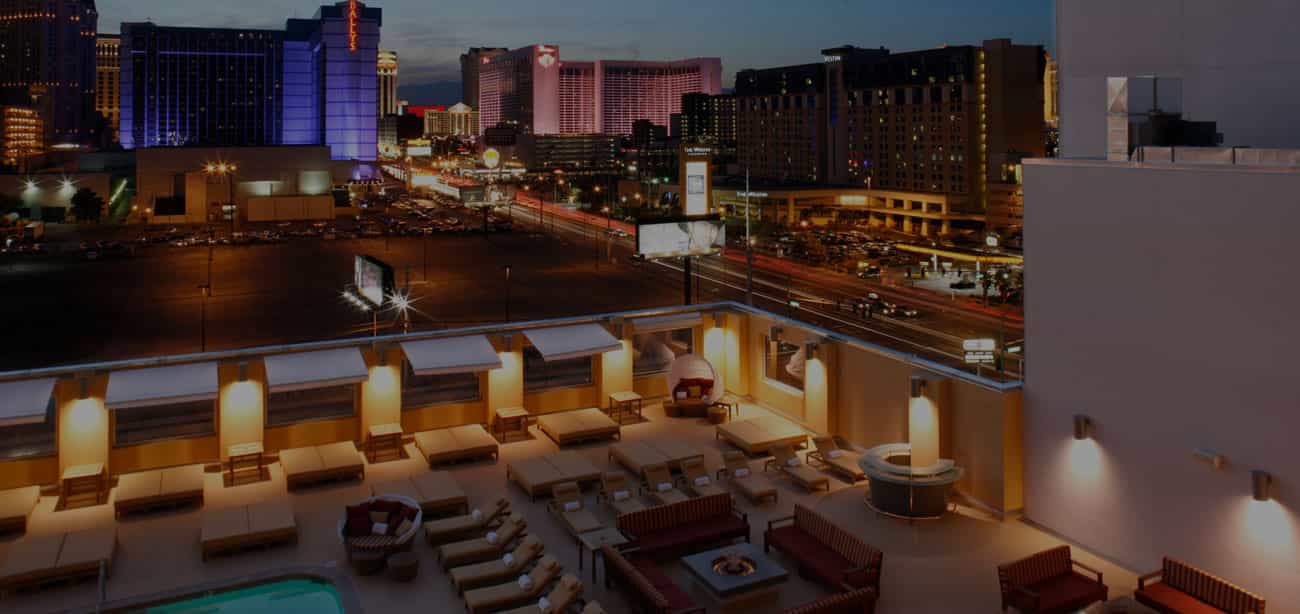 Platinum Hotel Las Vegas rooftop pool and lounge area at night.