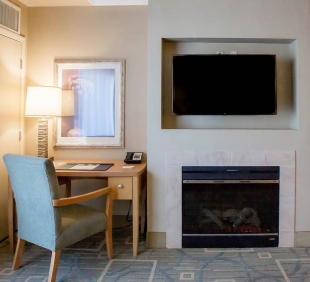 Desk area and fireplace in Platinum suite