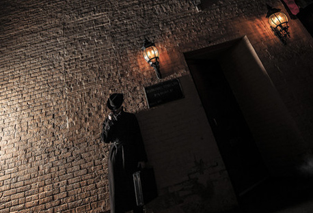 man in shadow by secret door