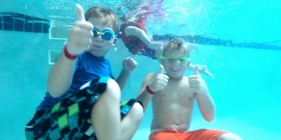 Boys swimming under water
