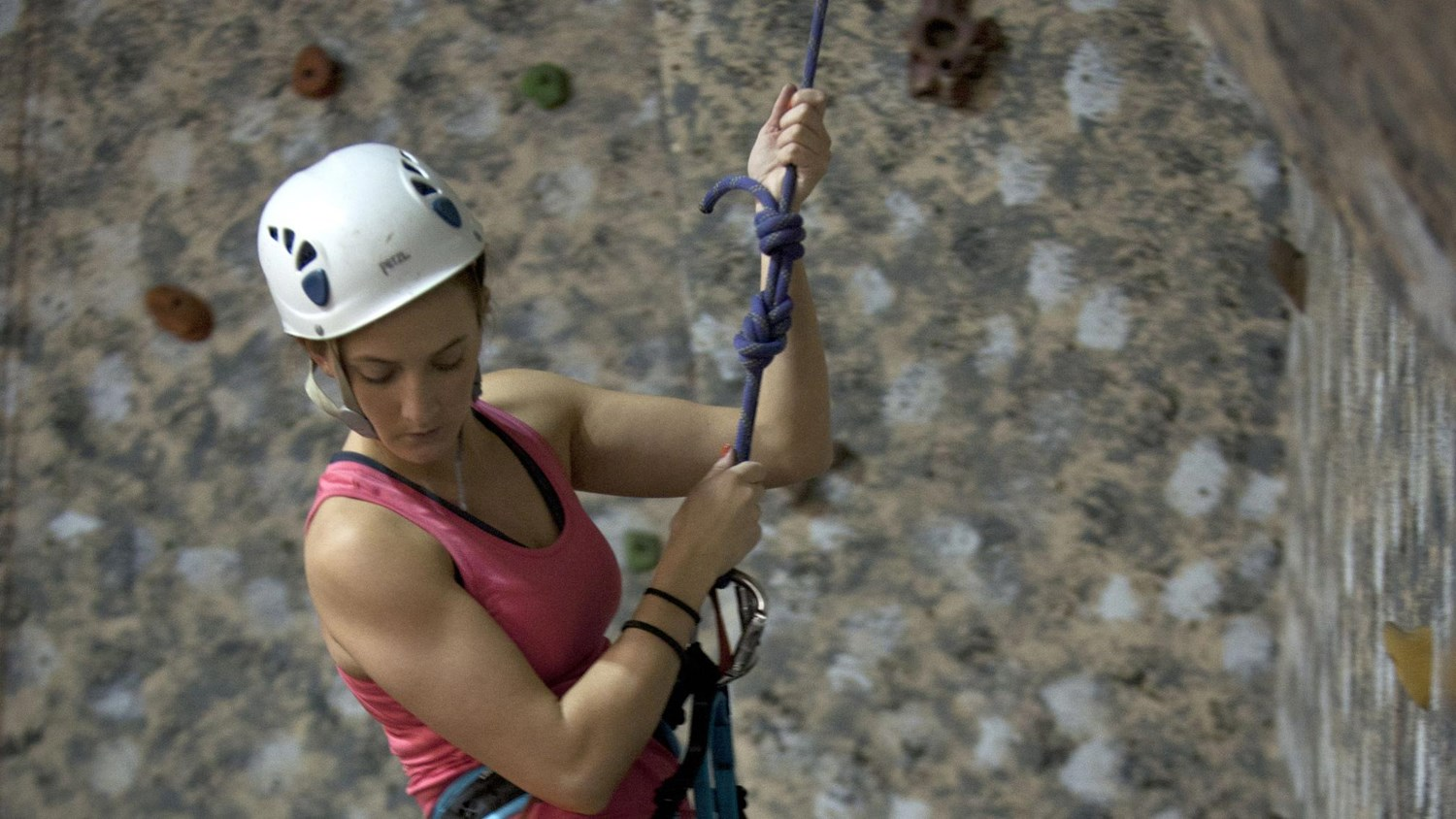 A young lady rock climbing
