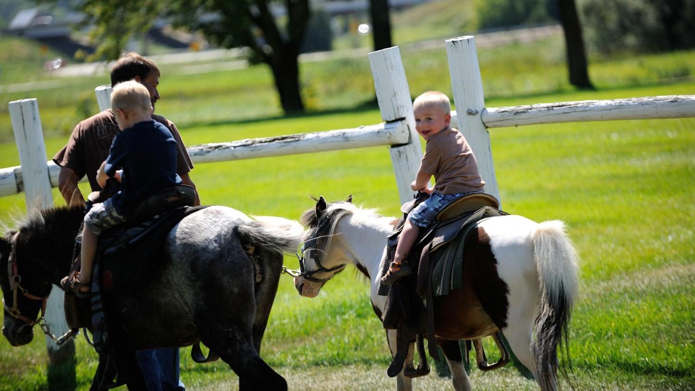 Kids taking a pony ride