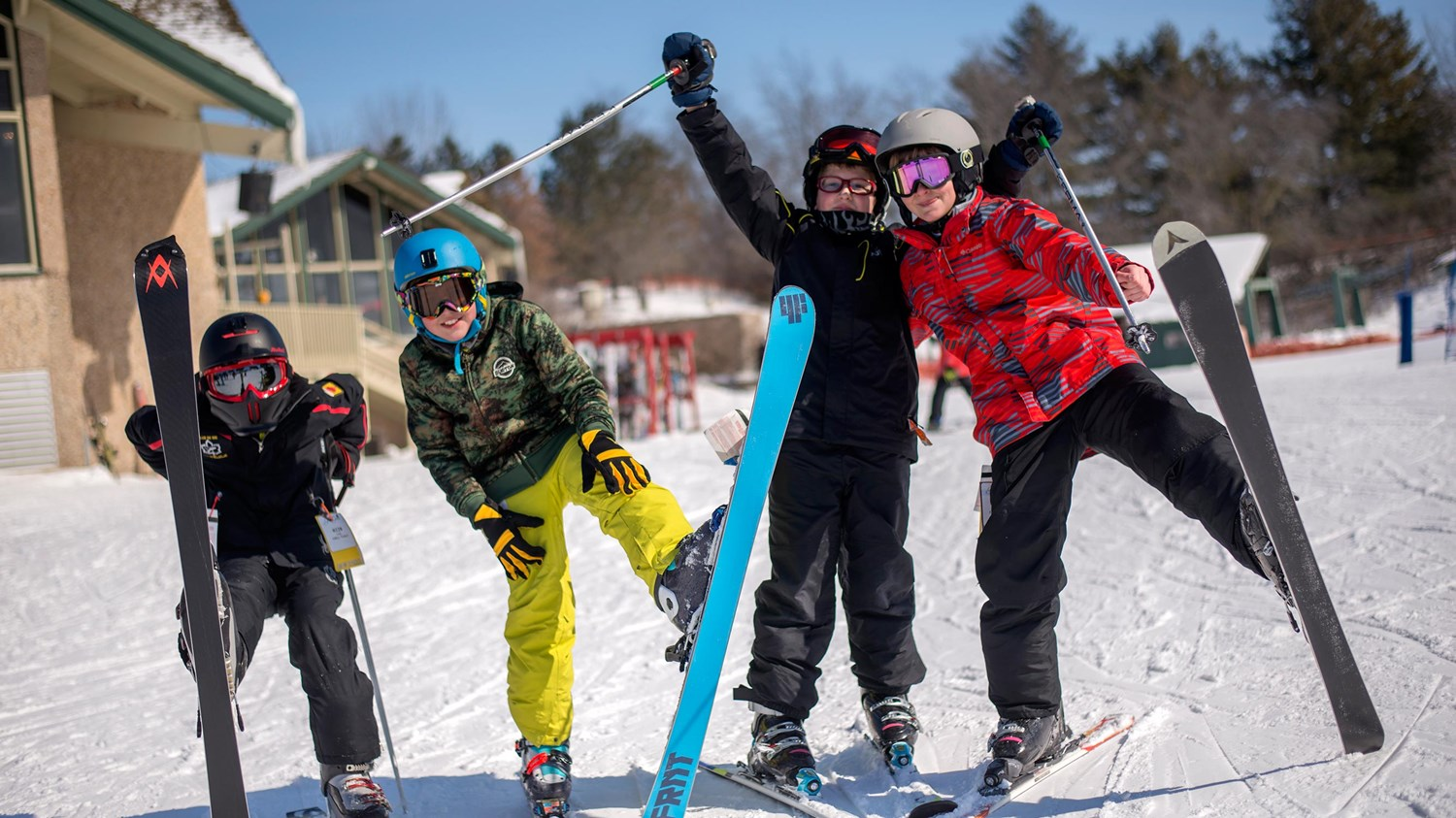 Kids posing with their skis