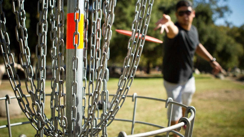 A man playing frisbee golf