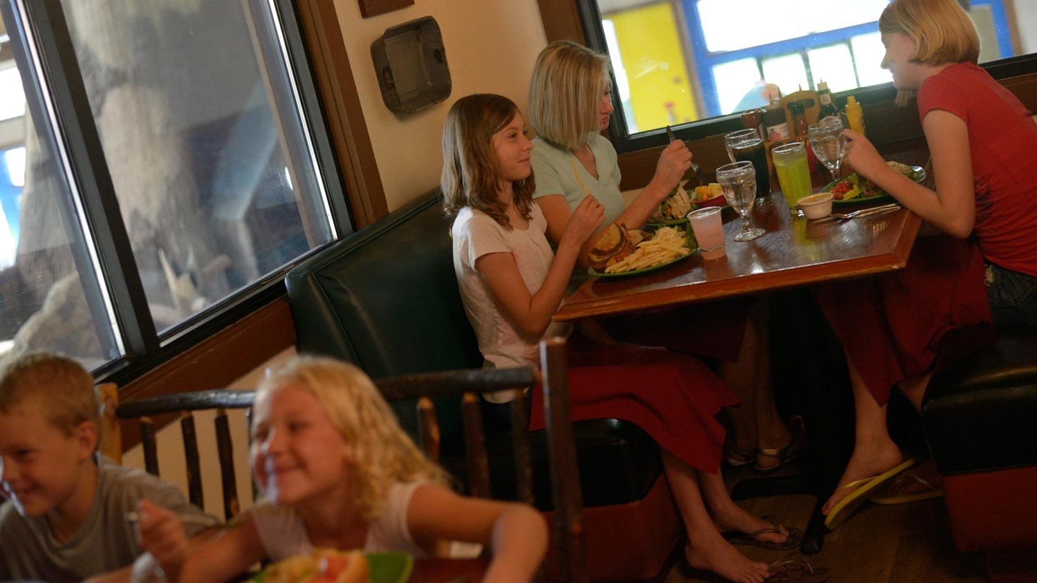 Family enjoying their meal at Smokeys