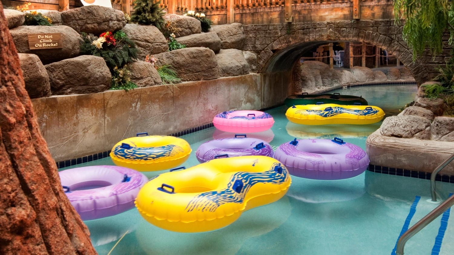 The lazy river running around the perimeter of the indoor waterpark