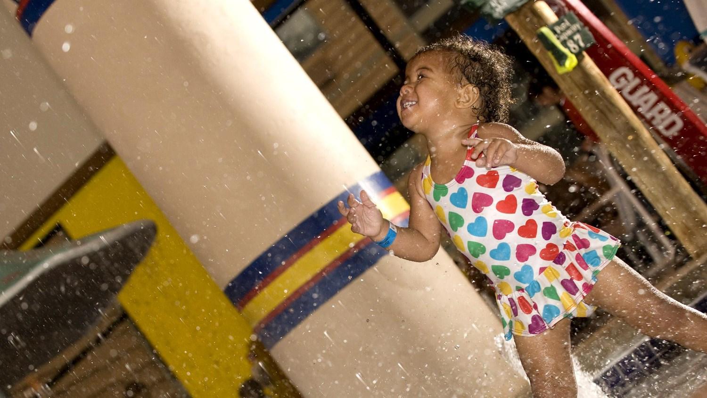 Toddler splashing in the kiddie pool